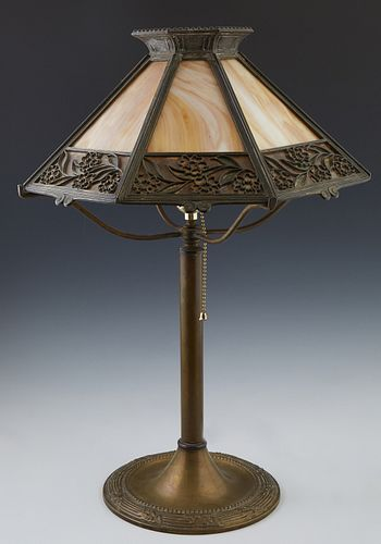 American Brass Slag Glass Table Lamp, c. 1920, by Bradley & Hubbard, the sloping octagonal caramel slag glass shade with floral relieg decoration, on