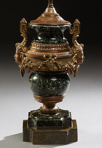 Empire Style Gilt Spelter Mounted Marble Lamp, early 20th c., of tapering urn form, the verde antico urn with relief classical masque handles, joined