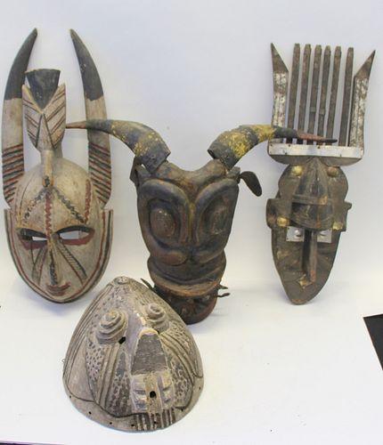 4 Antique Carved Wood African Masks.