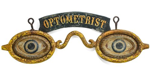 AN UNUSUAL OPTOMETRIST TRADE SIGN WITH EMBOSSED BANNER
