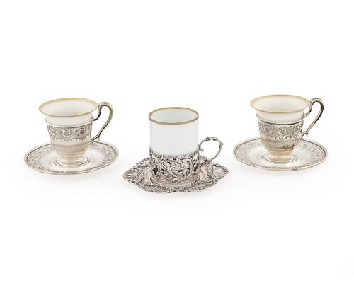 A Group of Silver Demitasse Frames and Saucers