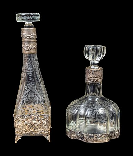 Two Continental Silver-Mounted Etched Glass Decanters Height of tallest 12 3/4 inches.
