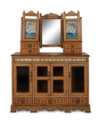 An Anglo-Indian Carved and Inlaid Sideboard with Swing Mirror Height 77 x width 58 1/2 x depth 20 3/4 inches.