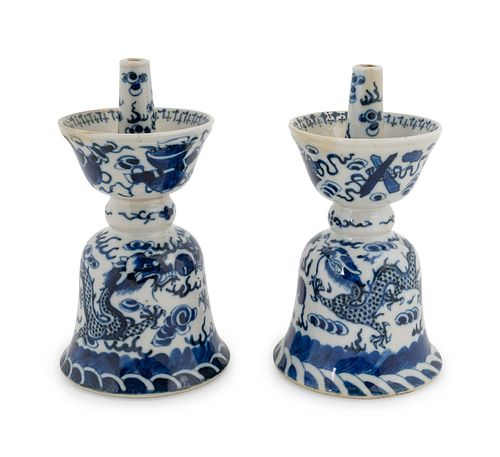A Pair of Chinese Blue and White Porcelain Candle Holders Height 6 1/4 inches.