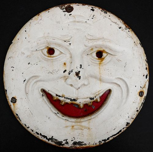 A SMILING 'MAN IN THE MOON IRON SHOOTING GALLERY TARGET