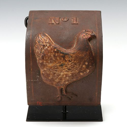 AN ANTIQUE CAST IRON COVER WITH HEN IN OLD PAINT