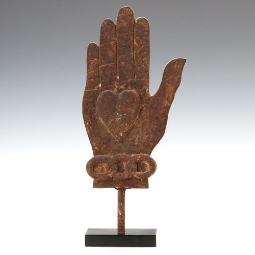A CAST IRON ODD FELLOWS HEART AND HAND SYMBOL C. 1890