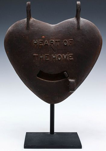 A CAST IRON HEART FORM STOVE DOOR
