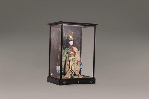 Geisha doll, Japan, early 20th century, inside a glass case