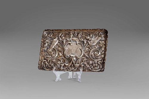 Embossed silver tray with floral motifs, central mask and birds