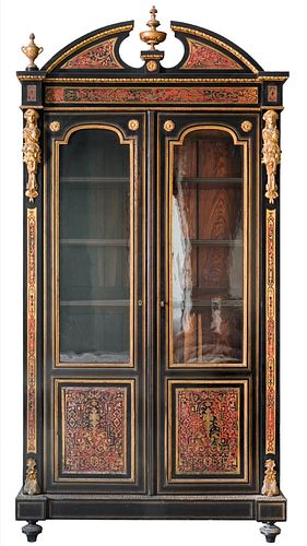 Boulle style display cabinet with two doors with rich brass decorations on a tortoiseshell background, circa 1860