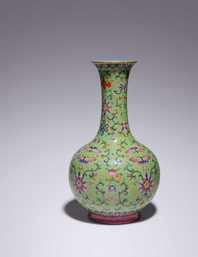A Lime-Green Ground Famille Rose Porcelain Bottle Vase Height 12 in., 30.48 cm