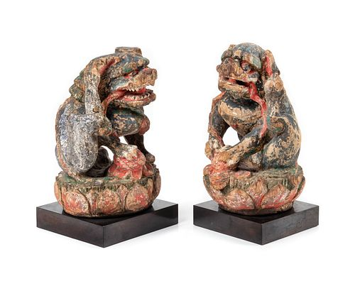 A Pair of Polychrome Painted Wood Figures of Fu Lions Height of figure 7 1/2 in., 19 cm.