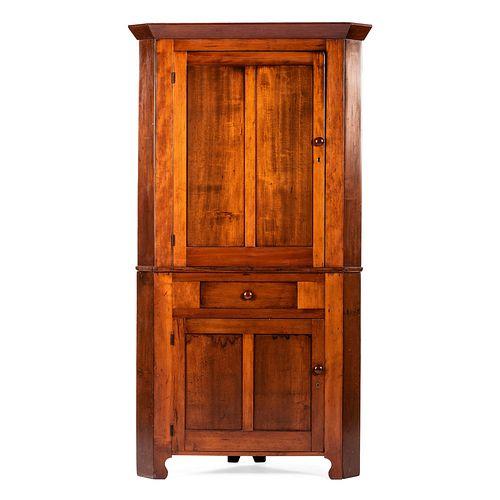 A Two Piece Paneled Cherry Corner Cupboard