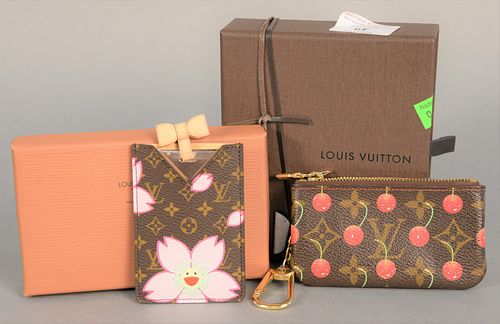Two Louis Vuitton pieces to include change purse, pochette monogram with cherries, includes original receipt, box, tags and dust bag along with etui m