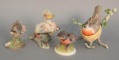 "Four Boehm porcelain sculpture bird group to include ""Blue Heron"" #200-19; ""Robin"" #40329; ""Baby Cardinal"" #400-57; ""Baby Robin"" #437."