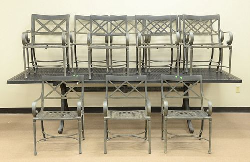 "Extra large metal outdoor table and twelve chairs, ht. 30 1/2"", top 48"" x 19""."