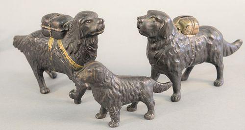 "Three iron dog still banks, ht. 5 1/2"", 5 1/2"" and 3 1/2, lg. 9.5""."