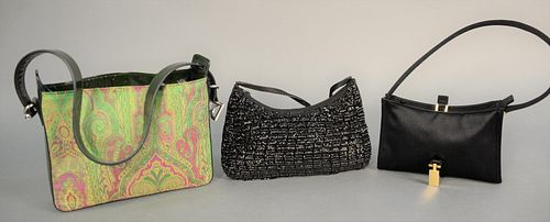Three clutch purses or handbags to include Gucci black satin clutch purse with original tag $525 and dust cover; Dolce & Gabbana paisley purse with ce