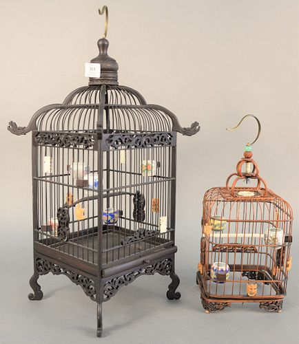 """Two Chinese bird cages having porcelain water and food bowls on interior, hts. 14 1/2"""" and 22"""". Estate of Marilyn Ware, Strasburg, PA."""