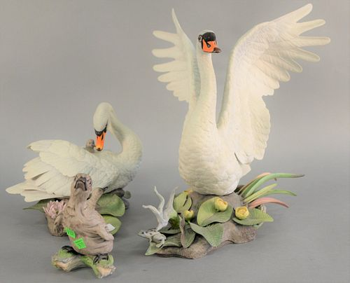 "Three Boehm ""Muted Swans"" porcelain sculpture group to include female with cygest 400 - 1A, male with wings spread 400 - 1A, and single cynet 400 - 27"