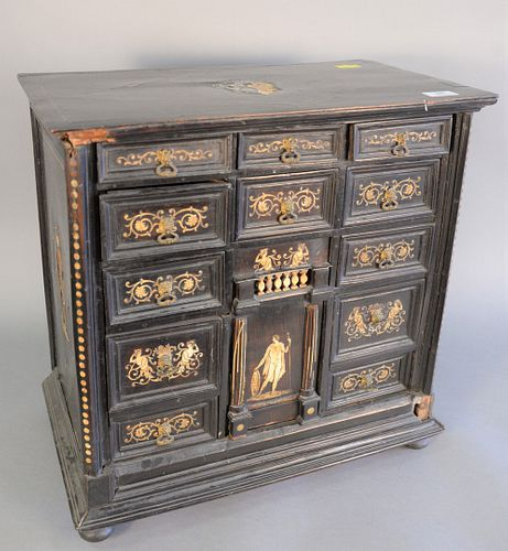 """Ebonized desk cabinet with thirteen drawers, bone inlay and ball feet (one foot missing), ht. 21"""", wd. 21""""."""