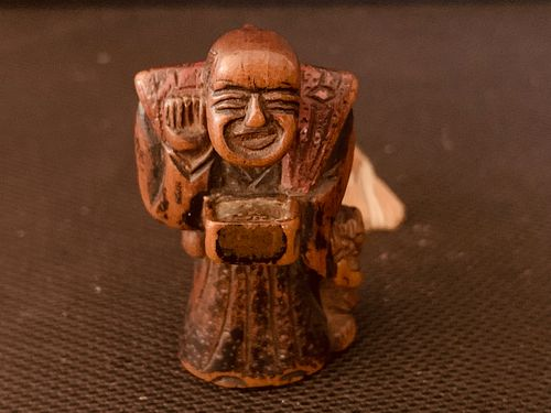 Fruitwood Netsuke of Man with Oni, Meiji Period
