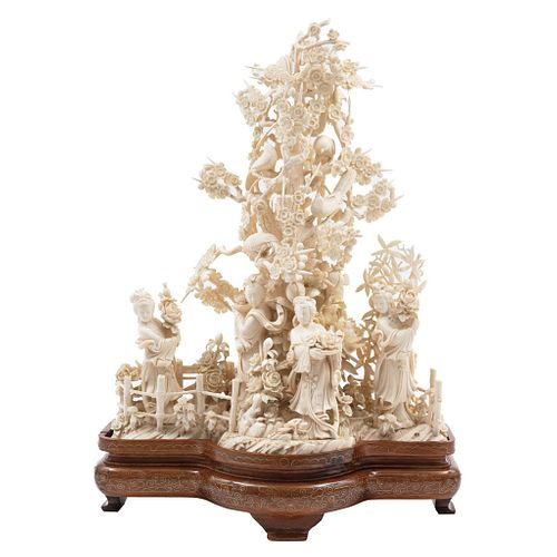 Oriental Scene, China, Ca. 1900. Openwork ivory representing a scene with characters, floral and plant motifs.