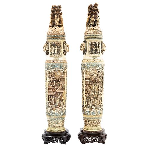 Pair of Urns, Asia, Ca. 1900, Carved and inked ivory with oriental scenes.