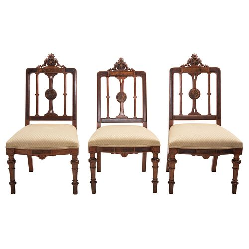 Lot of three chairs, 20th century, Carved wood with floral motifs and decorative details on backs.