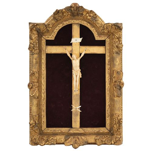 Ivory Christ, Early 20th century, Made in ivory with a carved wooden cross on a red velvet background.