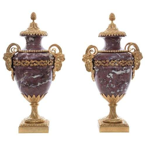 Pair of Jars, Early 20th century, Red marble, gold metal applications.