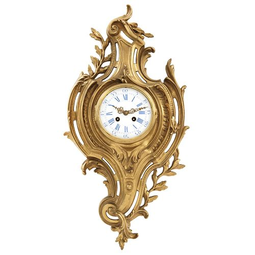 Clock, Early 20th century, In gilt bronze and decorated with plant motifs.