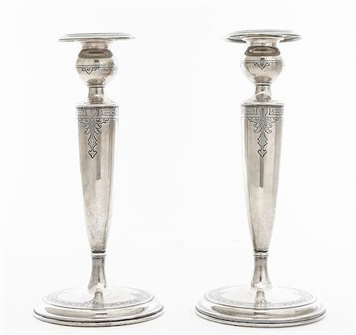 A Pair of American Silver Candlesticks, Lebkuecher & Co., Newark, NJ, with bulbous candle cups, weighted