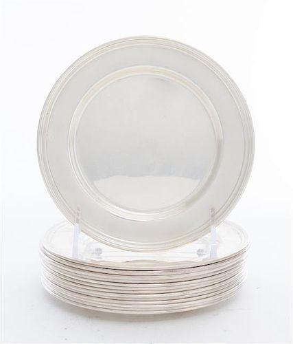 A Set of fourteen American Silver Bread Plates, International, each having a rolled edge, model H575