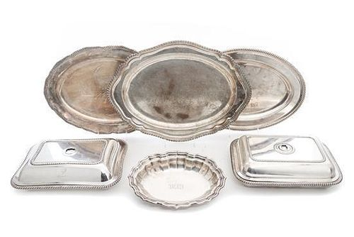 * A Group of Silver-plate Entree Dishes and Serving Trays Width of widest 18 inches