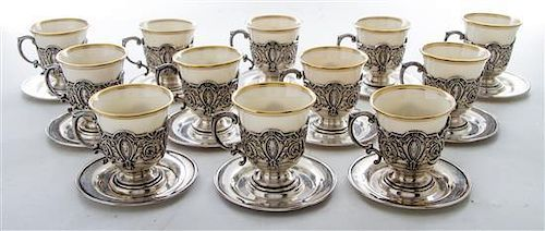 * A Set of Twelve American Silver Demitasse Cups and Liners, Dominick & Haff, New York, NY, each with a Lenox porcelain liner an