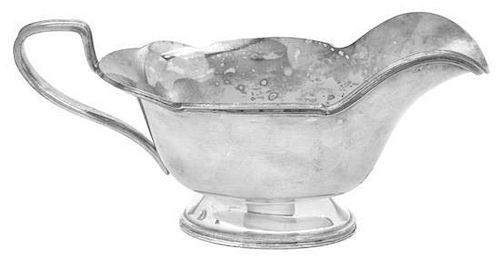 An American Silver-plate Sauce Boat, 20th Century, with shaped reeded rim and angular handle
