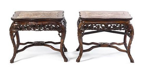 A Pair of Carved Wood End Tables. Height 18 3/4 x width 24 1/2 x depth 17 3/4 inches.
