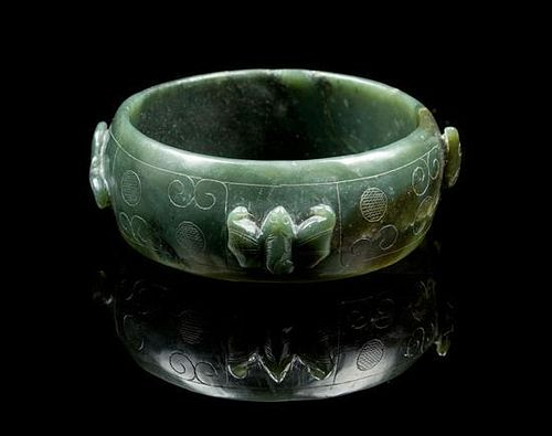 * A Carved Spinach Jade Bracelet Diameter overall 3 1/2 inches.