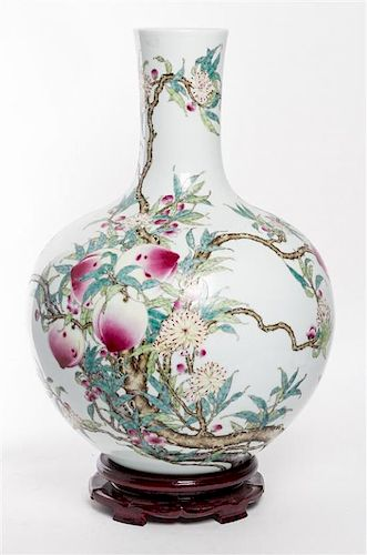 A Large Famille Rose Porcelain Vase, Tianqiuping Height 19 1/2 inches.
