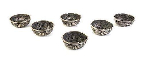 Six Tibetan Silvered Metal Bowls Diameter of each 4 7/8 inches.