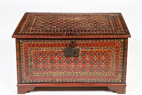 An Anglo-Moorish Mother-of-Pearl Inlaid Trunk Height 19 x width 34 1/2 x depth 18 inches.