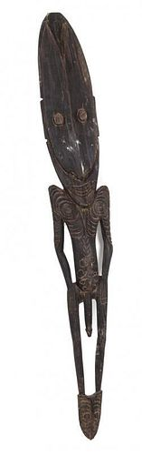 A Carved Wood Figure Height 47 inches.