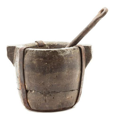 * An Iron and Turned Stone Mortar and Pestle Height of mortar 5 7/8 inches.