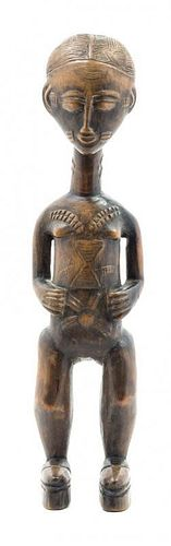 * An African Carved Figure Height 15 1/8 inches.