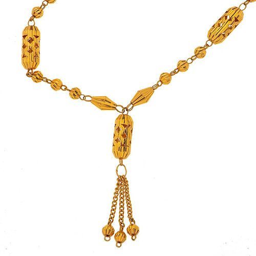 Collar en oro amarillo de 8k. Diseño de ovalos. Peso: 20.9 g.