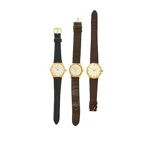 THREE MID SIZED 14K GOLD MECHANICAL WRISTWATCHES