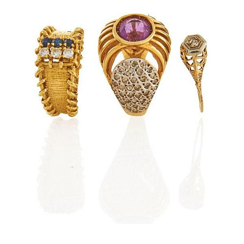 THREE DIAMOND OR GEM-SET YELLOW GOLD RINGS