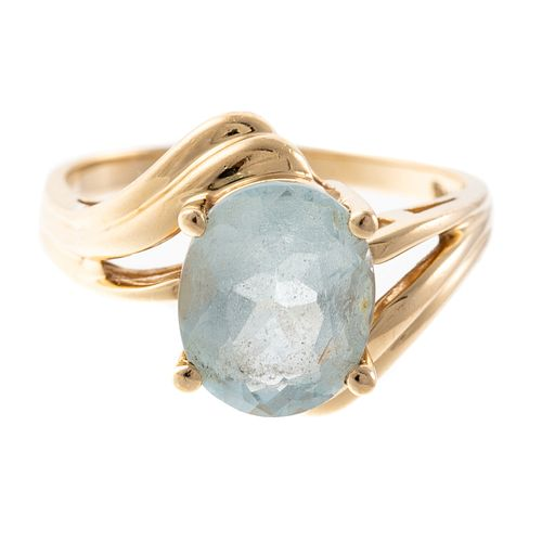 An Oval Cut Aquamarine Ring in 14K Yellow Gold